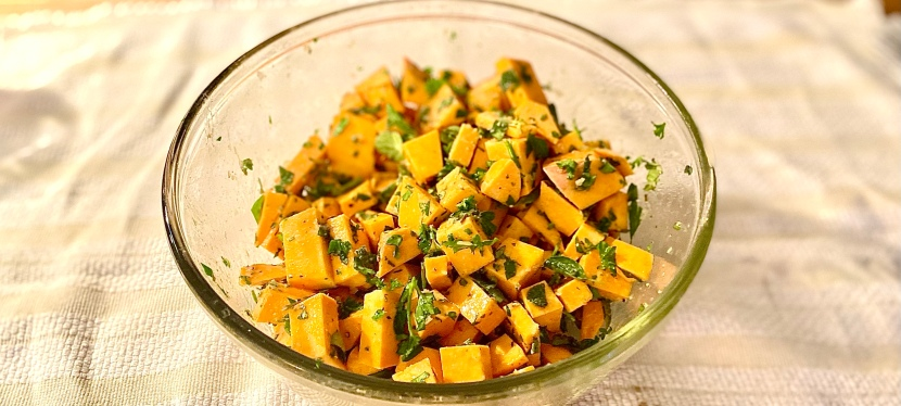 Sweet potato side dish with spring herbs andgarlic